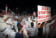 Kuwaitis protest near the US embassy in Kuwait City on September 13. The US boosted security at its embassies amid fears that more anti-American violence sparked by a film mocking Islam could erupt after Friday's Muslim prayers across the Middle East and North Africa