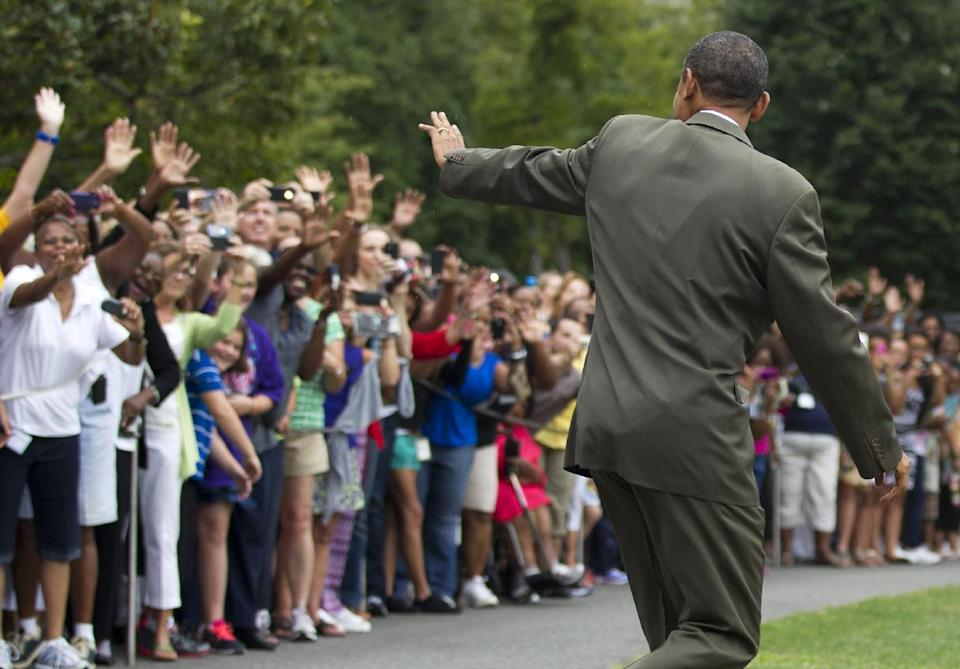 President Barack Obama waves to visitors as he leaves the White House in Washington, Saturday, Sept. 1, 2012,  for a campaign trip.   (AP Photo/Manuel Balce Ceneta)