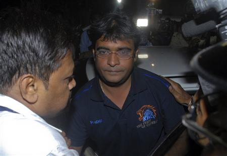 Police escort Gurunath Meiyappan, son-in-law of Indian cricket board (BCCI) President N Srinivasan, to the Crime Branch in Mumbai