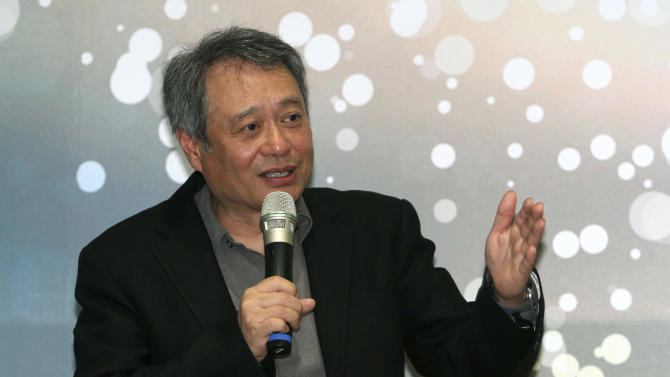 Taiwanese director Ang Lee gestures while answering a question during a press conference in Taipei, Taiwan, Thursday, May 9, 2013. The academy award winning director said Thursday that modesty and diligence have been the keys to his success in penetrating the foreign cultures that have framed the backgrounds for many of his most notable films. (AP Photo/Chiang Ying-ying)