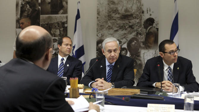 Israeli Prime Minister Benjamin Netanyahu, center, heads a special cabinet meeting marking  'Jerusalem Day' in the Ammunition Hill  memorial in Jerusalem, Sunday, May 20, 2012. 'Jeruslem Day' marks the anniversary of Israel's capture of the eastern part of the city in the 1967 Mideast war. Sitting second left is Jerusalem Mayor Nir Barkat. (AP Photo/Abir Sultan, Pool)