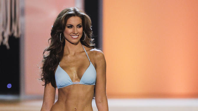 FILE - This June 3, 2012 file photo shows Miss Alabama, Katherine Webb, competing in the swimsuit competition during the 2012 Miss USA pageant in Las Vegas. Webb, Alabama quarterback AJ McCarron's model girlfriend,  became a hot topic on Twitter as her guy was helping the Tide blowout Notre Dame in the BCS NCAA college football game Monday night, Jan. 7, 2013. (AP Photo/Julie Jacobson, File)