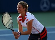 Belgium's Kim Clijsters bid what she vows will be a second and final farewell to her tennis-playing career with a mixed doubles loss at the US Open