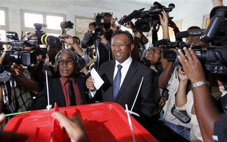 Madagascar's presidential candidate Hery Rajaonarimampianina holds his ballot before casting his vote at a polling centre in Tsimbazaza area of Antananarivo