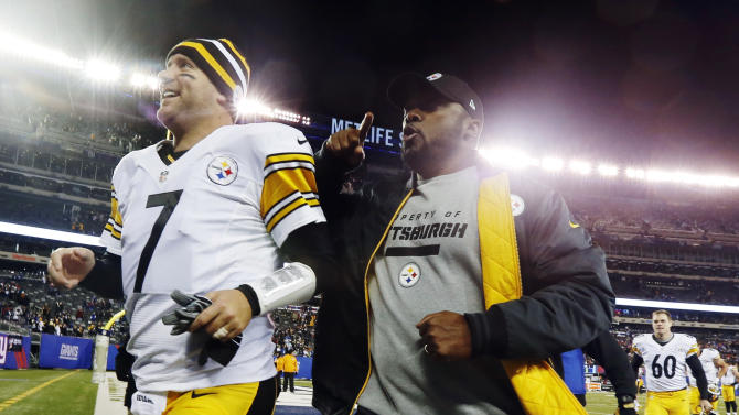 Pittsburgh Steelers head coach Mike Tomlin, right, runs off the field with quarterback Ben Roethlisberger (7) after an NFL football game against the New York Giants, Sunday, Nov. 4, 2012, in East Rutherford, N.J. The Steelers won 24-20. (AP Photo/Julio Cortez)