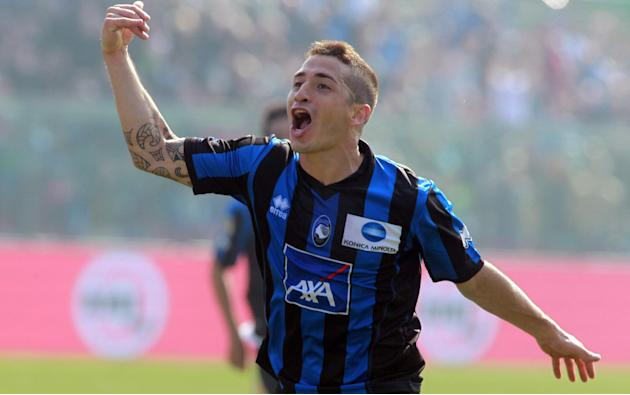 Atalanta's Carlos Carmona, of Chile, celebrates after scoring during a Serie A soccer match against Sampdoria in Bergamo, Italy, Sunday, March 16, 2014