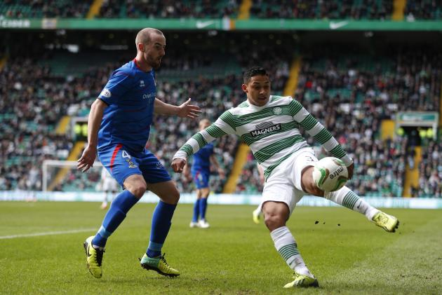 Inverness Caledonian Thistle's Vincent challenges Celtic's Izaguirre during their Scottish Premier League soccer match in Glasgow