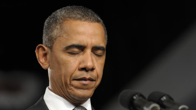 President Barack Obama pauses during a moment of silence for the victims of the Aurora, Colo., shooting during an event at the Harborside Event Center in Ft. Myers, Fla., Friday, July 20, 2012. Obama said the tragic movie theater shooting in Colorado that left 12 people dead is a reminder that life is fragile. (AP Photo/Susan Walsh)