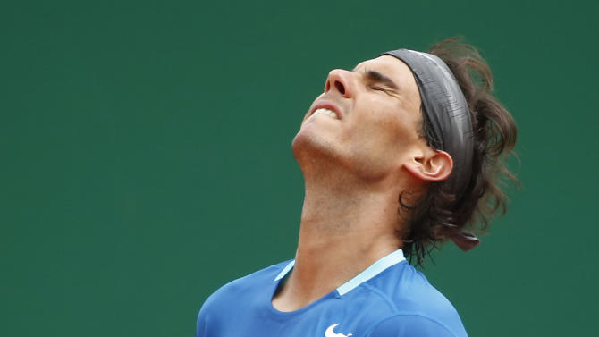 Rafael Nadal of Spain reacts after losing a point against David Ferrer of Spain during their quarterfinals match of the Monte Carlo Tennis Masters tournament in Monaco, Friday, April 18, 2014. Ferrer won 7-6 6-4. (AP Photo/Michel Euler)