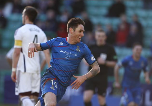Inverness Caledonian Thistle's Tansey celebrates his goal against Hearts during their Scottish League Cup semi final soccer match in Edinburgh