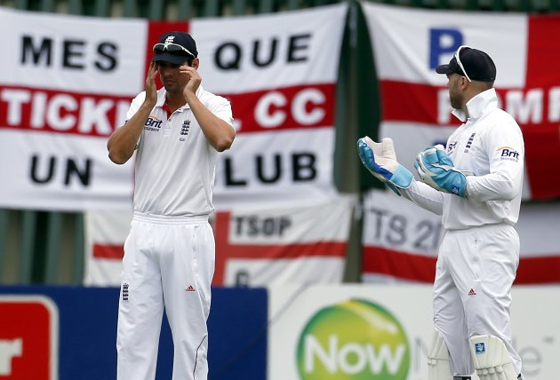 England's captain Cook reacts as he talks with team mate and wicket keeper Prior during the third day of the first test against New Zealand at the University Oval in Dunedin