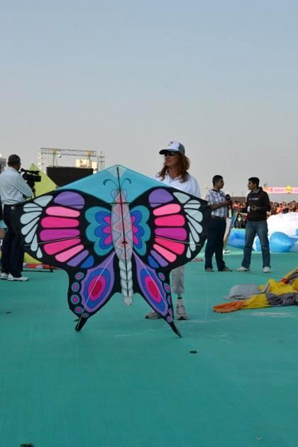 A butterfly kite readies for takeoff