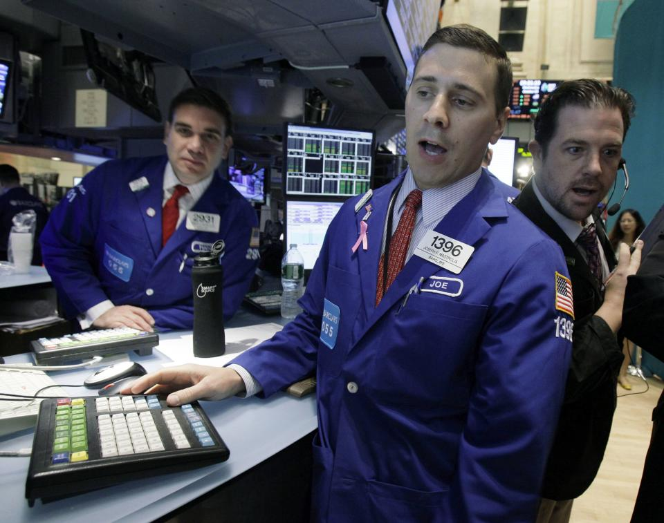 Specialist Joseph Mastrolia, center, works at his post on the floor of the New York Stock Exchange Wednesday, Oct. 3, 2012. Stocks are mostly higher in early trading on Wall Street Wednesday after a measure of private sector hiring came in better than economists were expecting. (AP Photo/Richard Drew)