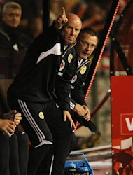 Peter Houston insists he will step down if Craig Levein, right, is removed as Scotland coach