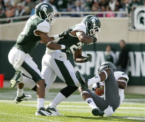 No. 21 Michigan State puts away E Michigan, 23-7