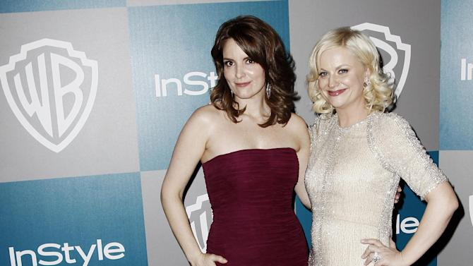"FILE - In this Jan. 15, 2012 file photo, Tina Fey, left, and Amy Poehler arrive at the 2012 Warner Bros. and InStyle Golden Globe After Party at the Beverly Hilton in Los Angeles. Tina Fey and Amy Poehler are ready to crack each other up at the Golden Globe Awards on Sunday, Jan. 13, 2013. The two multi-hyphenate talents offered a taste of their quick-witted banter during a conference call with reporters Wednesday, Jan. 9,  during which Fey promised, ""We're going to sing the whole show."" (AP Photo/Matt Sayles, File)"