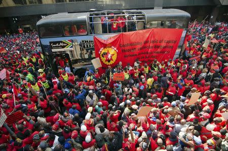 Members of the National Union of Metalworkers march on the first day of a nationwide strike in Johannesburg