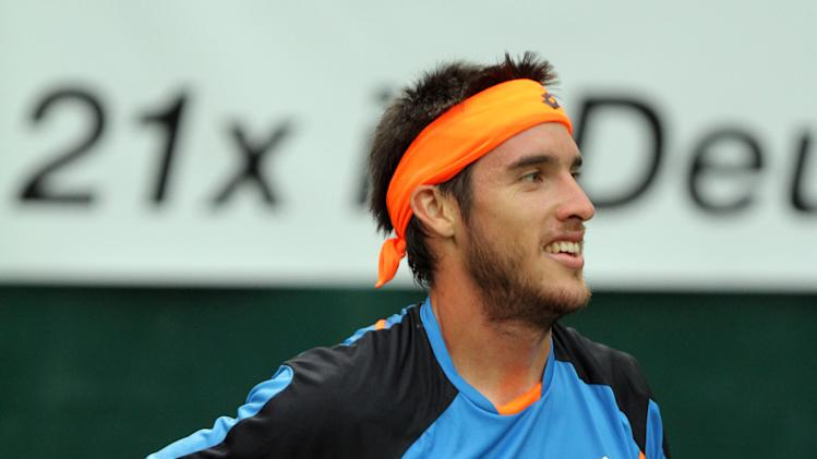 Argentina's  Leonardo Mayer reacts during his match against German  Florian Mayer  at the ATP gery Weber Open tennis tournament in Halle, Westphalia, Germany Thursday June 13, 2013.  (AP Photo/dpa, Oliver Krato)