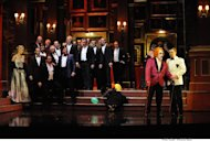 This Sept. 15, 2010 photo released by Opera Australia shows the cast of Opera Australia&#39;s &quot;Rigoletto,&quot; in Sydney. The first of Giuseppe Verdi&#39;s three great middle period triumphs has been shifted before to New York&#39;s Little Italy, Federico Fellini&#39;s Rome, modern-day Hollywood and even the Oval Office. Now it will take place amid dazzling Sin City lights and not in the Renaissance Palazzo Ducale when Michael Mayer&#39;s version of the 162-year-old classic opens Monday night. (AP Photo/Opera Australia, Branco Gaica)