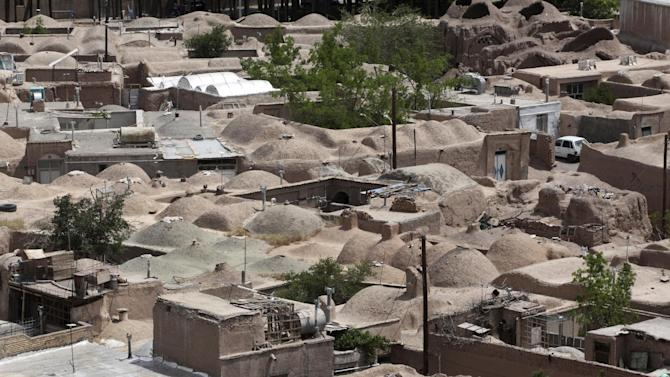 In this picture taken on Tuesday, May 6, 2013, a general view of rooftops in an old district of the eastern city of Birjand, Iran. When struggling families in the eastern Iranian city of Birjand take measure of Mahmoud Ahmadinejad's presidency in its waning weeks, it's not about his browbeating oratory against the West or his battles with Iran's ruling clerics. Instead, it's the rows of simple two-story homes on the city's outskirts that sharply improved their lives. (AP Photo/Vahid Salemi)