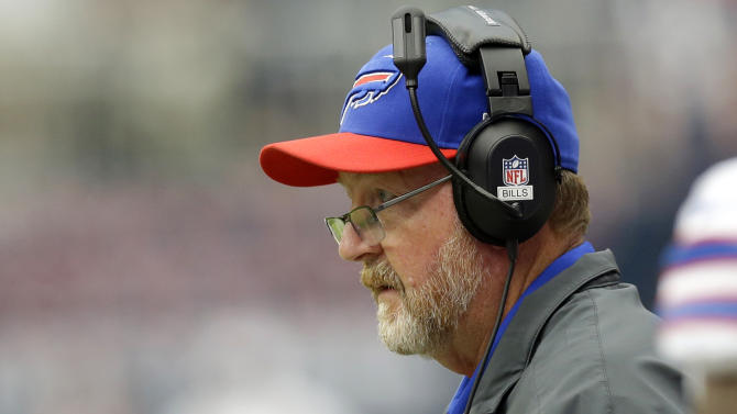 Buffalo Bills' Chan Gailey  keeps an eye on the game against the Houston Texans in the second quarter of an NFL football game on Sunday, Nov. 4, 2012, in Houston. (AP Photo/Eric Gay)