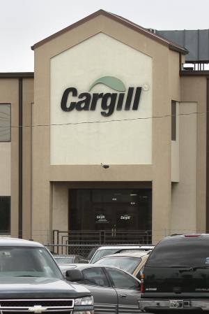 FILE - In this Aug. 4, 2011 file photo, the company logo is displayed at the Cargill plant in Springdale, Ark. The U.S. Labor Department said Tuesday, Nov. 29, 2011, one of the nation's largest meatpackers systematically discriminated against more than 4,000 qualified applicants who sought entry-level jobs at a turkey processing plant in Arkansas. (AP Photo/Danny Johnston, File)