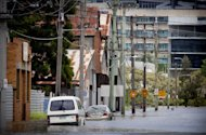 Partly submerged cars are seen in floodwaters on a street in the inner Brisbane suburb of Newmarket, on January 28, 2013. Helicopters have plucked dozens of stranded Australians to safety in dramatic rooftop rescues as severe floods swept the northeast, killing four people and inundating thousands of homes