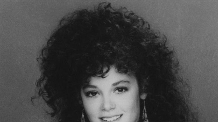 "** FILE ** In this 1987 file image, Rebecca Schaeffer, who played Patti on CBS TV's ""My Sister Sam,"" poses in a publicity photo. The model-actress was murdered on July 19, 1989, when an obsessed fan named Robert Bardo shot and killed her at the door of her Los Angeles apartment. Schaeffer's death prompted reforms that made stalking a crime, prevented the Department of Motor Vehicles from releasing home addresses, and the creation of a specialized police unit to protect celebrities and dignitaries. (AP Photo/CBS, file)"