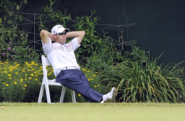 Brian Davis takes a break on the tenth hole of the third round of the Travelers Championship golf tournament in Cromwell, Conn., Saturday, June 23, 2012. (AP Photo/Fred Beckham)