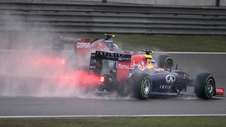 Red Bull Racing Formula One driver Ricciardo of Australia and Toro Rosso Formula One driver Kvyat of Russia drive during the third practice session of the Chinese F1 Grand Prix at the Shanghai International circuit