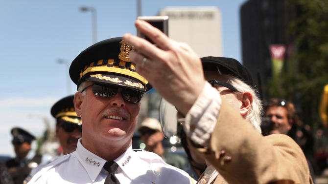 Chicago Police Superintendent Garry McCarthy, left, poses for a photo after protesters marched to President Obama's campaign headquarters Monday, May 21 2012, in Chicago, the final day of the NATO summit. (AP Photo/Charles Rex Arbogast)