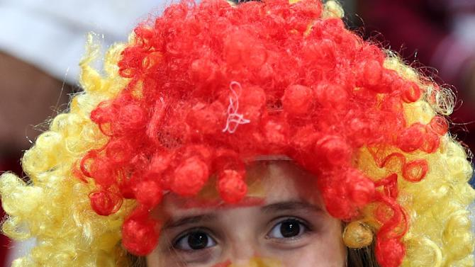 A Spanish fan cheers during the 24th Men's Handball World Championships semifinal match between France and Spain at the Lusail Multipurpose Hall, in Doha, Qatar, Friday, Jan. 30, 2015. (AP Photo/Osama Faisal)