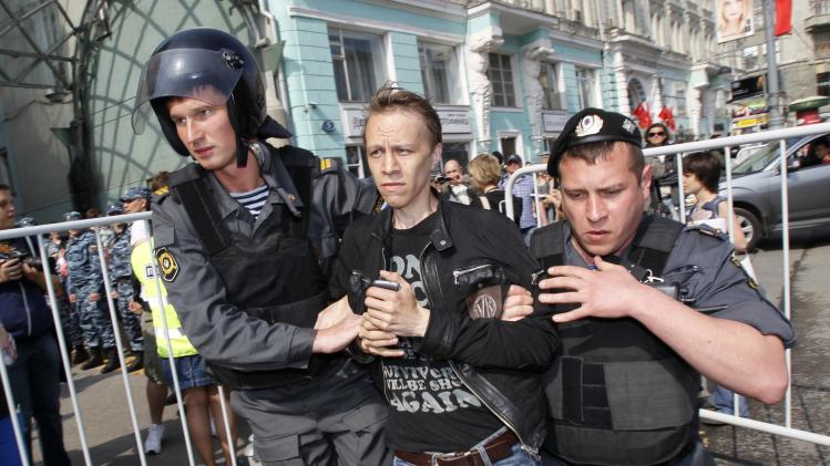 Police detain protesters in downtown Moscow shortly before Vladimir Putin's inauguration Monday, May 7, 2012. Putin's inauguration on Monday comes a day after an opposition protest drew more than 20,000 people, fewer than the mass demonstrations that preceded his election but still a sign that the anger over Putin's return to the Kremlin has not faded. (AP Photo/Ivan Secretarev)