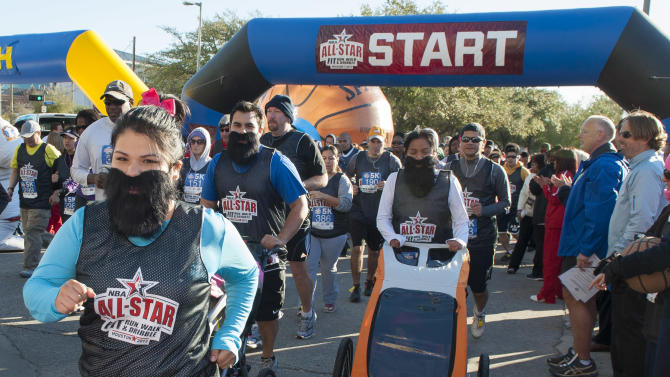 IMAGE DISTRIBUTED FOR RELIANT - Reliant employees wear James Harden beards as they start the NBA All-Star Run, Walk and Dribble 5K Run, Saturday, Feb. 16, 2013, in Houston. (Dave Einsel/AP Images for Reliant)