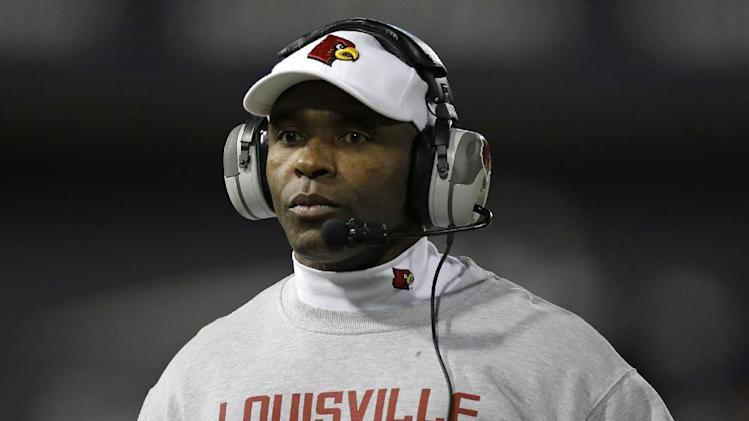 Louisville head coach Charlie Strong watches from the sidelines in the first half of an NCAA college football game against Cincinnati, Thursday, Dec. 5, 2013, in Cincinnati
