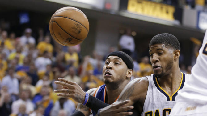 New York Knicks' Carmelo Anthony, left, and Indiana Pacers' Paul George vie for a rebound during the first half of Game 4 of an Eastern Conference semifinal NBA basketball playoff series, on Tuesday, May 14, 2013, in Indianapolis. (AP Photo/Darron Cummings)