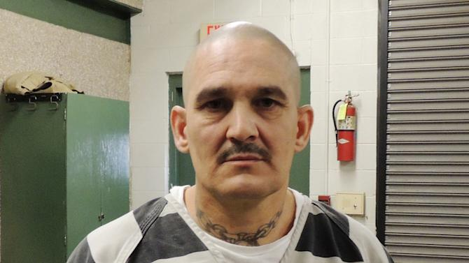This photo provided by the Hopkins County Sheriff's Office shows Brian Allen Tucker. On Tuesday, April 2, 2013, Tucker, an inmate awaiting trial on a capital murder charge in a 2011 slaying, and another prisoner, John Marlin King, broke out of the Hopkins County Jail. The two have spent a second night on the run as officials investigate whether the men stole a vehicle and have a gun. (AP Photo/The Hopkins County Sheriff's Office)