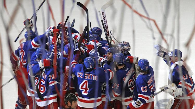 The New York Rangers celebrate Marc Staal's overtime goal against the Washington Capitals in Game 5 of the NHL hockey Stanley Cup Eastern Conference semifinals at Madison Square Garden in New York, Monday, May 7, 2012. The Rangers won 3-2. (AP Photo/Kathy Willens)