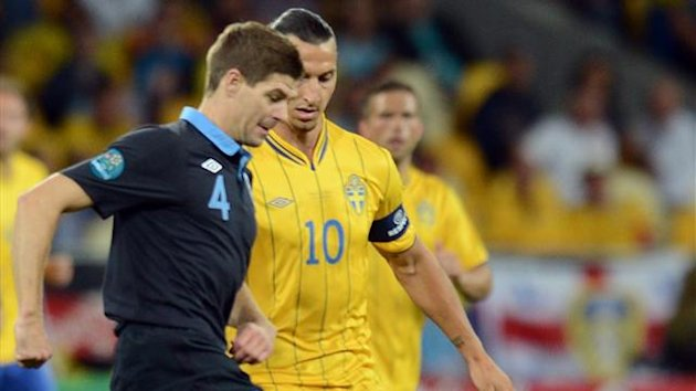 Swedish forward Zlatan Ibrahimovic (R) vies with English midfielder Steven Gerrard