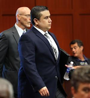 George Zimmerman arrives in Seminole circuit court, with co-counsel Don West, on the first day of his trial, in Sanford, Fla., Monday, June 10, 2013. Zimmerman is accused in the fatal shooting of Trayvon Martin.    (AP Photo/Orlando Sentinel,Joe Burbank, Pool )
