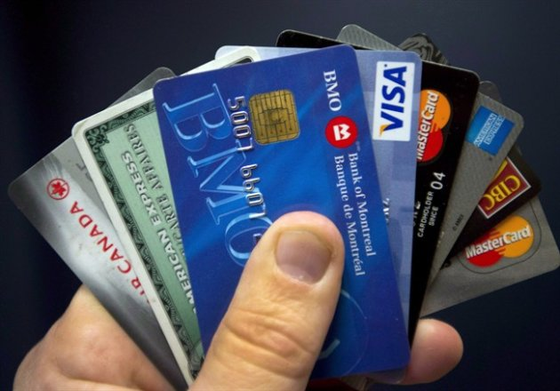 Credit cards are displayed in Montreal on December 12, 2012. THE CANADIAN PRESS/Ryan Remiorz