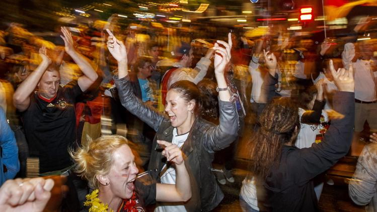 German fans celebrate at the 'Reeperbahn' red light district in Hamburg after Germany won the World Cup soccer final against Argentina