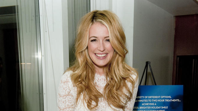 "IMAGE DISTRIBUTED FOR CREST WHITESTRIPS -  ""So You Think You Can Dance""'s Cat Deeley flashes her white, bright smile, and encourages others to transform their smile this holiday season, at the Crest Whitestrips Holiday Soiree, at the Hudson Hotel on Wednesday, Nov. 28, in New York. (Photo by Scott Gries/Invision for Crest Whitestrips)"