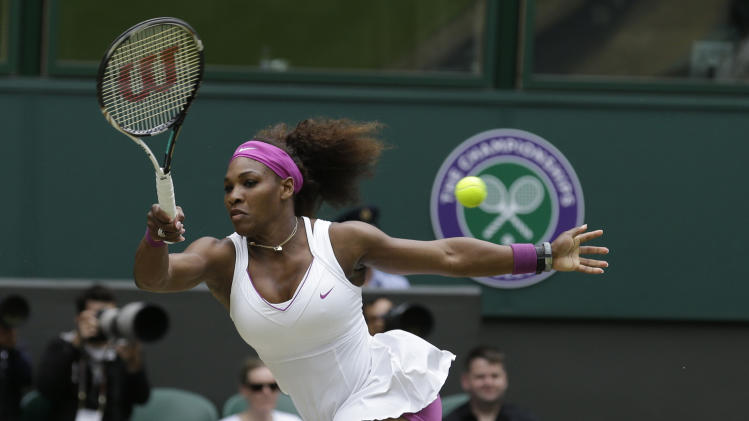 Serena Williams of the United States plays a shot to Victoria Azarenka of Belarus during a semifinals match at the All England Lawn Tennis Championships at Wimbledon, England, Thursday, July 5, 2012. (AP Photo/Anja Niedringhaus)
