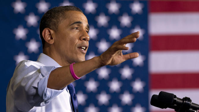 President Barack Obama gestures as speaks at a campaign event at Cornell College, Wednesday, Oct. 17, 2012, in Mt. Vernon, Iowa. The president sports a pink bracelet in honor of October being breast cancer awareness month.  (AP Photo/Carolyn Kaster)