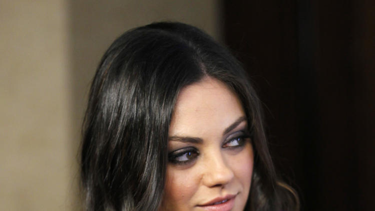 Actress Mila Kunis poses at the benefit gala for the 50th anniversary of St. Jude Children's Research Hospital in Beverly Hills