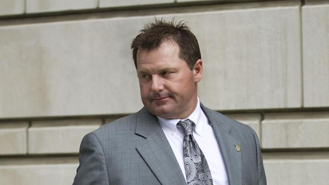 Former Major League Baseball pitcher Roger Clemens prepares to sign an autograph as he leaves federal court in Washington, Monday, May 21, 2012, after a day of testimony in the sixth week of the perjury trial that will determine whether Clemens lied to Congress in 2008 when the 11-time All-Star pitcher denied using performance-enhancing drugs.  (AP Photo/Manuel Balce Ceneta)
