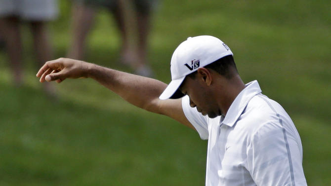 Tiger Woods takes a drop on the fourth hole during the third round of The Players championship golf tournament at TPC Sawgrass, Saturday, May 11, 2013 in Ponte Vedra Beach, Fla. (AP Photo/Gerald Herbert)