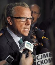Saskatchewan Premier Brad Wall speaks to reporters in Regina on Monday, Sept. 9, 2013. Wall says musician Neil Young's comparison of the oilsands to Hiroshima is insensitive and ignorant of the facts.THE CANADIAN PRESS/Michael Bell