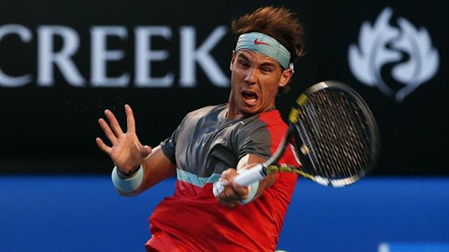 Rafael Nadal of Spain hits a return to Stanislas Wawrinka of Switzerland during their men's singles final match at the Australian Open 2014 tennis tournament in Melbourne January 26, 2014 (Reuters)
